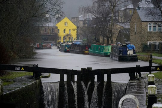 TODMORDEN, UNITED KINGDOM - JANUARY 20: Water over flows the canal lock during heaving rain on January 20, 2021 in Todmorden, United Kingdom. Storm Christoph is the first named storm of 2021 with heavy rainfall bringin flooding areas of the UK including Cambridgeshire, Greater Manchester and South Yorkshire. (Photo by Christopher Furlong/Getty Images)