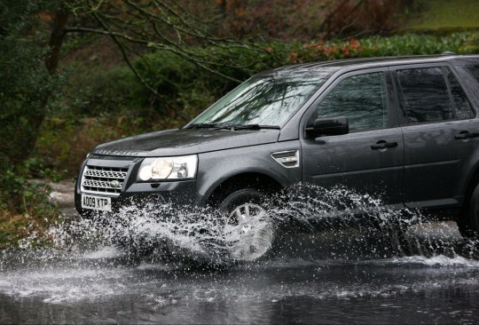 Mandatory Credit: Photo by Adam Vaughan/SOPA Images/REX (11719022b) A car seen splashing water as it moves on a waterlogged street during a heavy rainfall in Holmfirth. Parts of the UK including South Yorkshire and Greater Manchester are on high alert as Storm Christoph brings heavy rain, which is expected to cause floods and widespread disruption. Storm Christoph brings heavy rains in Holmfirth, UK - 20 Jan 2021