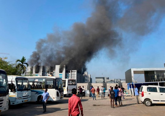 Smoke rises from the Serum Institute of India, the world's largest vaccine maker that is manufacturing the AstraZeneca/Oxford University vaccine for the coronavirus, in Pune, India, Thursday, Jan. 21, 2021. (AP Photo/Rafiq Maqbool)