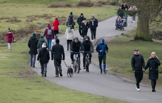 People enjoy a walk at Bradgate Park in Leicestershire