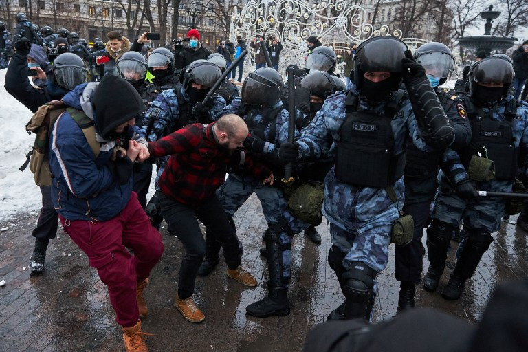 MOSCOW, RUSSIA - JANUARY 23: Riot police clash with supporters of Alexey Navalny, Russian opposition leader, during a demonstration on January 23, 2021 in Moscow, Russia. Earlier this week, Kremlin-critic Alexei Navalny called for supporters to protest after he was remanded to pre-trial detention for 30 days. His arrest came one day after his return to Russia, following his poisoning with a nerve agent last summer. (Photo by Oleg Nikishin/Getty Images)