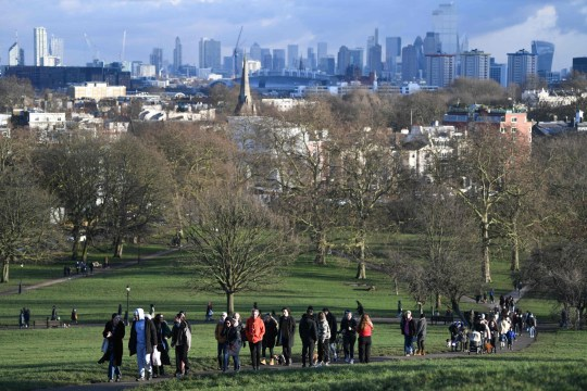 People take daily excercise at Primrose Hill, north London