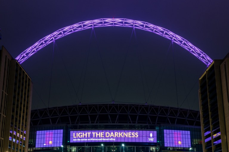 LONDON, ENGLAND - JANUARY 27: Wembley Stadium is lit in purple light to mark Holocaust Memorial Day on January 27, 2021 in London, United Kingdom. Holocaust Memorial Day is an international event that remembers the millions of Jews exterminated in World War II at the hands of the Nazis. The 27th January is the anniversary of the liberation of Auschwitz-Birkenau, the largest Nazi death camp, at the end of the War in 1945. (Photo by Chris J Ratcliffe/Getty Images)