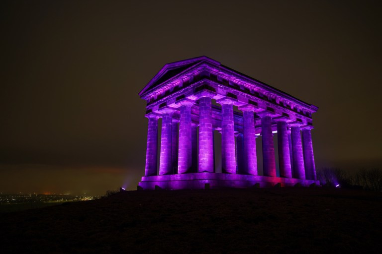 SUNDERLAND, ENGLAND - JANUARY 27: Penshaw Monument near Sunderland is bathed in purple light to commemorate Holocaust Memorial Day on January 27, 2021 in Sunderland, England. Landmarks across the country were lit with purple light to commemorate Holocaust Memorial Day while the traditional remembrance ceremony was hosted online due to lockdown rules. Holocaust Memorial Day takes place on 27th January each year, the anniversary of the liberation of Auschwitz by Allied troops at the end of WWII. The theme for Holocaust Memorial Day 2021 is ???Be the light in the darkness???. (Photo by Ian Forsyth/Getty Images)