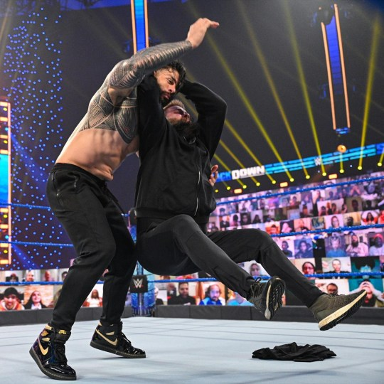 WWE superstars Roman Reigns and Kevin Owens on SmackDown in January 2021