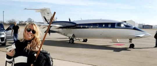 Jenna Ryan in front of private jet