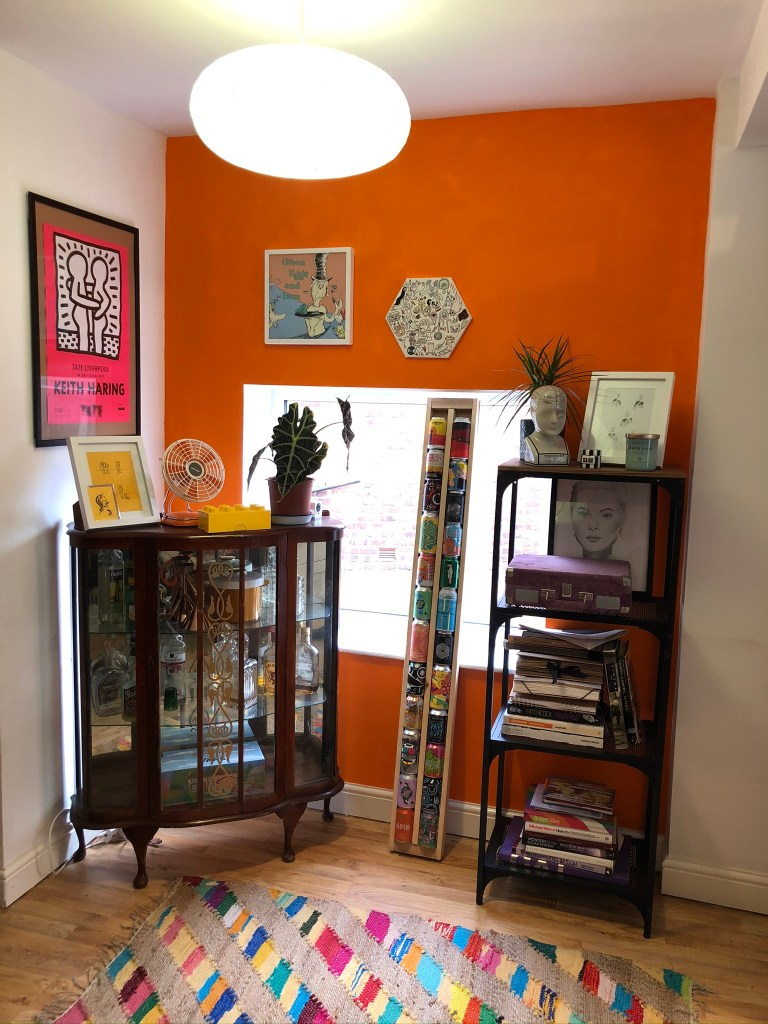 What I Rent: Iona and Jack, Oldham, Manchester - orange wall with drinks cabinet and beers
