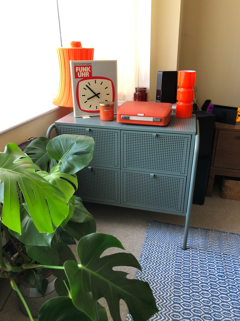 What I Rent: Iona and Jack, Oldham, Manchester - blue metal chest of drawers with funk uhr clock and plants