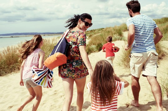 A young family head to the beach