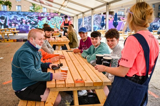 Members of the public enjoy their first drink in a beer garden at SWG3 on July 06, 2020 in Glasgow, Scotland.
