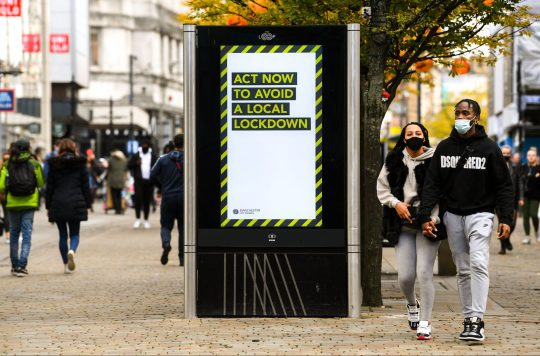 Mandatory Credit: Photo by James Veysey/REX (10966498l) 'Act now to avoid a local lockdown' signage Coronavirus restrictions, Manchester, UK - 20 Oct 2020