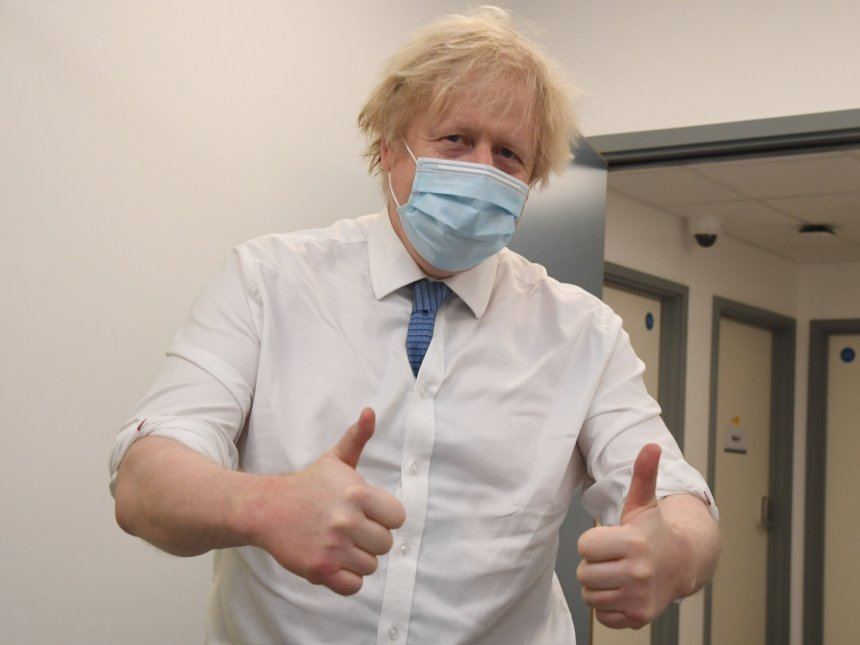 Britain's Prime Minister Boris Johnson poses during a visit to a coronavirus vaccination hub at the Health and Well-being Centre in Orpington, southeast London
