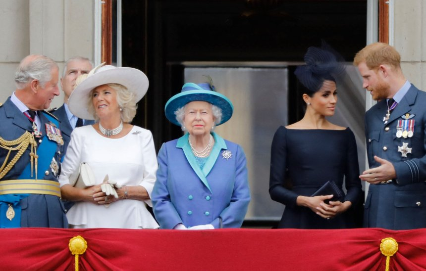 Prince Charles, Prince of Wales, Britain's Camilla, Duchess of Cornwall, Britain's Queen Elizabeth II, Britain's Meghan, Duchess of Sussex and Britain's Prince Harry, Duke of Sussex, stand on the balcony of Buckingham Palace to watch a military fly-past to mark the centenary of the Royal Air Force (RAF). Prince William is said to be upset over Harry and Meghan's 'insulting' response to the Queen about service.