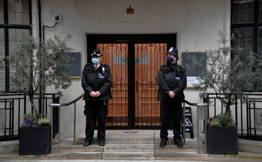 Police officers stand outside King Edward VII's Hospital, where Britain's Prince Philip was admitted. Prince Philip is spending a sixth day in hospital.