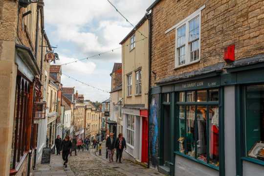 Pedestrians walk along the High Street in Frome.  Frome Neighbourhood Policing Team is looking for a man who has been pushing cash and letters through random residents' postboxes.