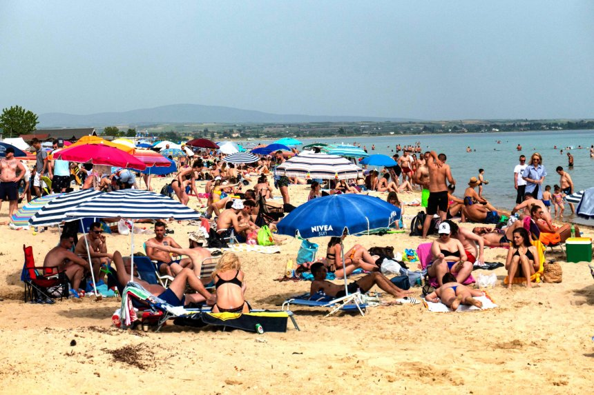 The overcrowded beach of Potamos in Epanomi during a heatwave, a beach near Thessaloniki and Halkidiki. Beach bars and organized beaches are open since Saturday 16 May 2020. Crowds of people, beachgoers are seeing relaxing, swimming and sunbathing without the advised by the government measures against the Covid-19 Coronavirus pandemic, like social distancing or masks. Greece is easing gradually the lockdown allowing people to travel within the region without permission and opening the shops. Hotels, Resorts and Beach Bars are still closed in Greece due to the quarantine. Tourism is the main income industry for Greece offering idyllic holidays for tourists around the world so the country will accept on June 15 to Athens and Thessaloniki flights with tourists from abroad and from July 1st directly to the islands. May 2020 (Photo by Nicolas Economou/NurPhoto via Getty Images)