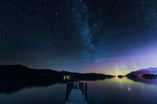 The Milky Way and Aurora Borealis from a jetty over Derwent water in Keswick in the Lake District (Credits: Getty Images)
