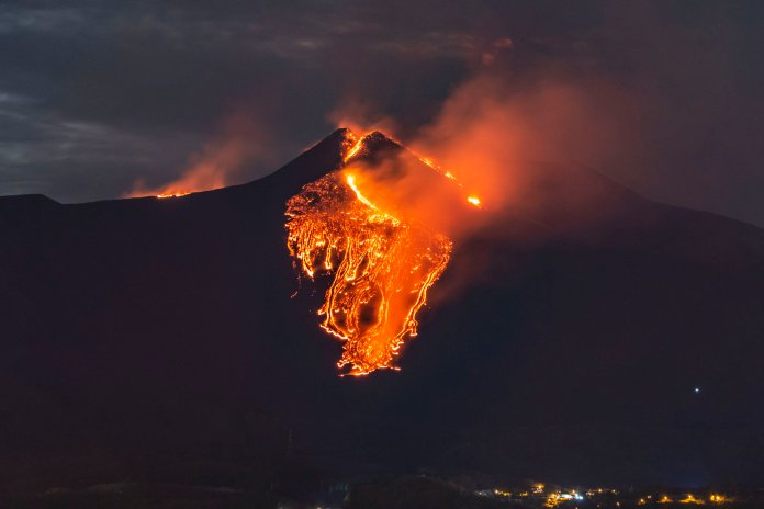 Lava flows from the Mt Etna volcano, near Catania in Sicily, southern Italy, early Tuesday, Feb. 23 , 2021. The explosion started before midnight on Monday night, provoking a huge eruption plume that rose for several kilometers from the top of Etna, as reported by The National Institute of Geophysics and Volcanology, Etneo Observatory. (AP Photo/Salvatore Allegra)