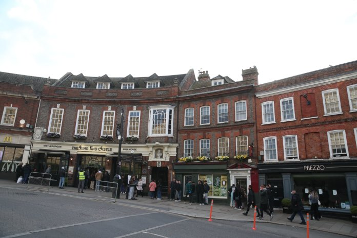 People line up outside Wetherspoon's, King and Castle pub in Windsor