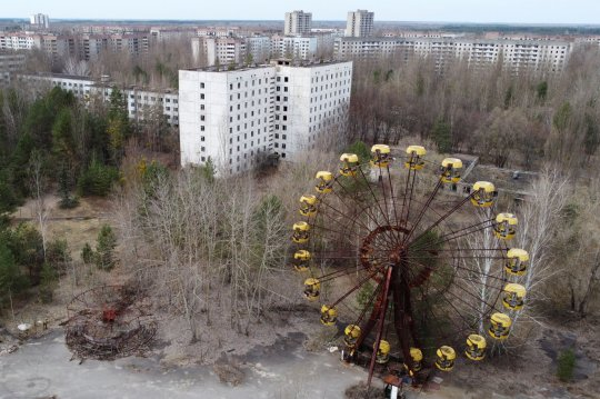 A view shows the abandoned city of Pripyat near the Chernobyl Nuclear Power Plant, Ukraine, April 12, 2021. Picture taken with a drone April 12, 2021. REUTERS/Gleb Garanich