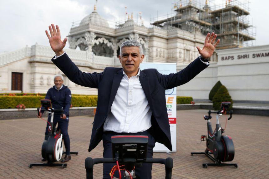Sadiq Khan raises his hands