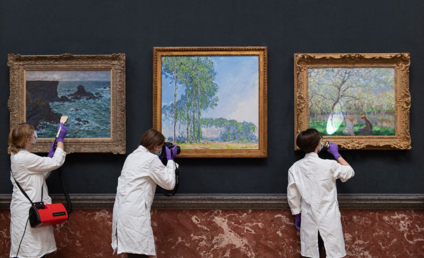 Conservators dust, photograph and inspect Rocks at Port Coton, the Lion Rock, Poplars and Springtime by Claude Monet at the Fitzwilliam Museum in Cambridge as they make final preparations to reopen to the general public following the easing of lockdown restrictions in England.