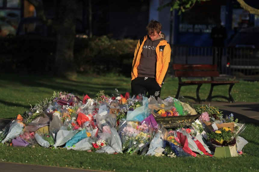 Patrick James, the son of PCSO Julia James, looks at floral tributes left near her family home in Snowdown, near Aylesham, East Kent. Picture date: Tuesday May 4, 2021. PA Photo. Kent Police launched a murder enquiry following the discovery of the 53-year-old community support officer's body near to her home on Tuesday April 27. See PA story POLICE Akholt. Photo credit should read: Gareth Fuller/PA Wire