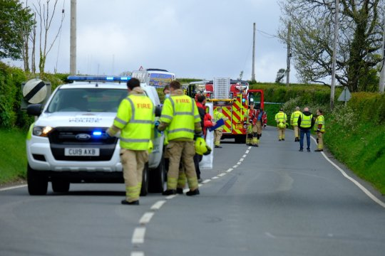 Pictured: Emergency services on the A478 road near Llandissilio in Wales, UK.  Monday 17 May 2021 Re: Emergency services are the scene of a serious collision on the A478 near Llandissilio in Pembrokeshire, Wales, UK.  The collision involved an automobile and a bus carrying schoolchildren and was reported to police at 8:35 am A number of children sustained minor injuries, two of whom were taken to hospital by ambulance with what is described as minor injuries.  The road is currently closed and officers remain at the scene.