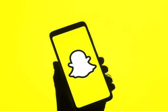 In this photo illustration, Snapchat logo is seen on a