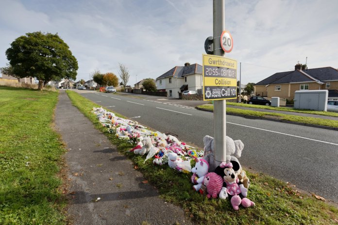 Flowers, toys and tributes left on Corporation Avenue, by Heol Goffa