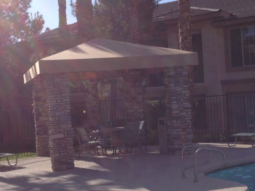 Custom Pool Side Canopy with Stone Brick Support Structure