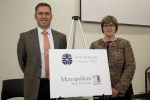 Metropolitan State Executive Vice President and Provost Ginny Arthur, North Hennepin Community College Vice President for Academic and Student Affairs Landon Pirius celebrate this partnership that provides bachelors degrees to students in the west metro, where demand is increasing.