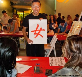 children and adults practice Chinese lettering