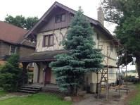 1890s chalet-style house gets primer coat