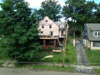 Work progresses on porch roof