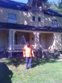 Homeowner Paul Gibbs painting his Wick Park property