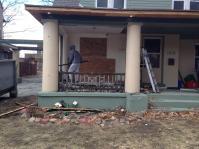 Neighbor Rob Pilolli helps reveal an original balustrade