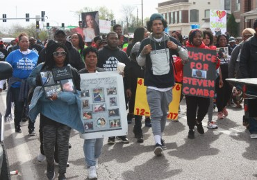 Mourners march, calling for end to the violence