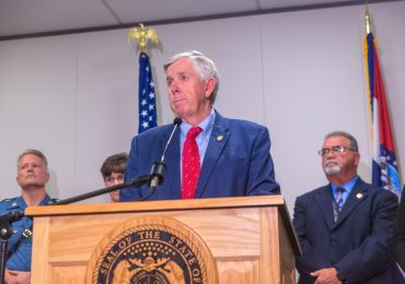 Parson cuts spending as virus hits Missouri economy