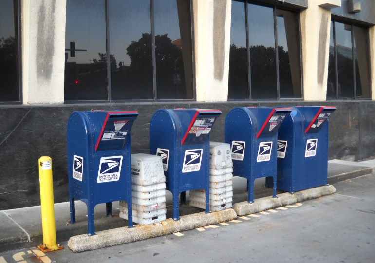 Postal Service agrees to reverse service changes