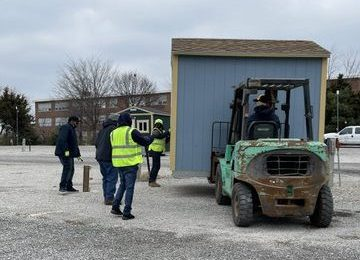 First tiny houses roll in for 'village' on north side
