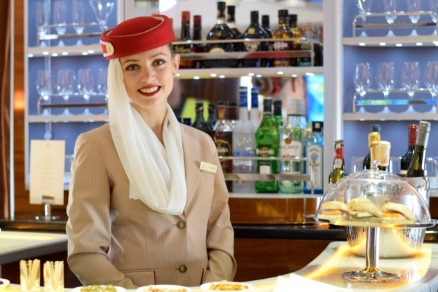 Emirates_flight_attendant_in_the_Airbus_A380_bar