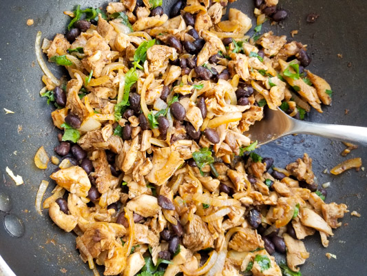 Black bean and chicken mixture cooking in a skillet for the Smoky Black Bean Chicken Quesadillas