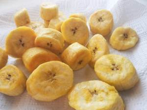 Cooked plantain slices. Drain excess oil off plantain on paper towels.