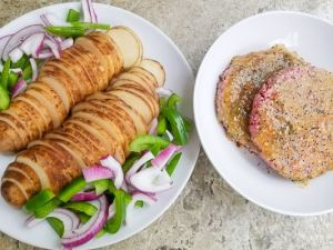 Potatoes, red onions and scalloped potatoes with marinating hamburgers on separate plates for the Hamburger Foil Packets.