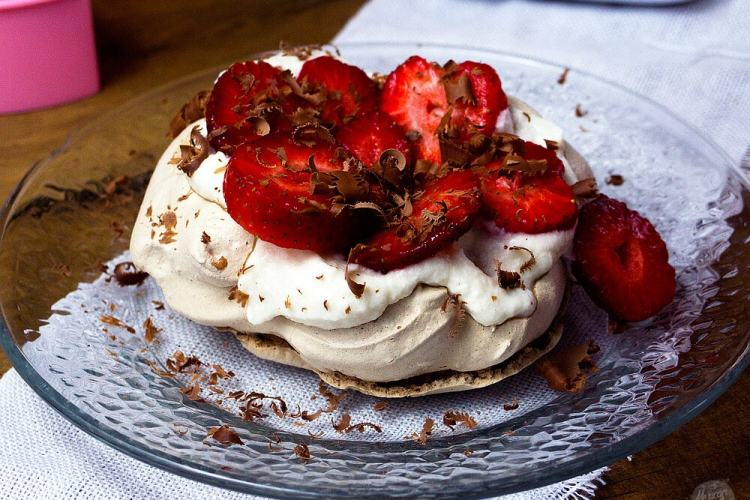 Chocolate Pavlova Topped with Strawberries and Whipped Cream