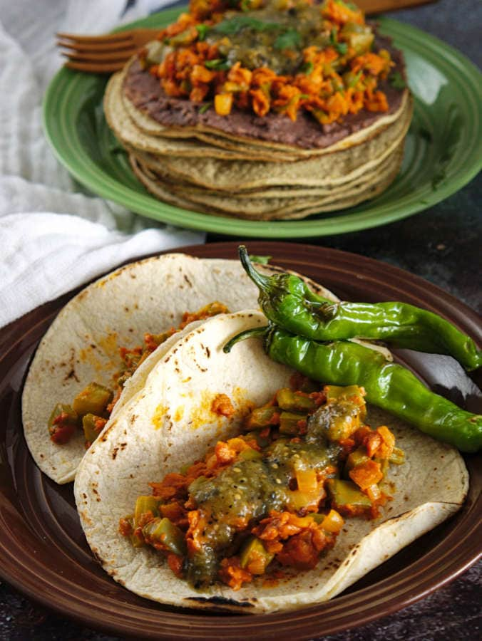 Chorizo and nopales tacos with spicy charred green salsa.