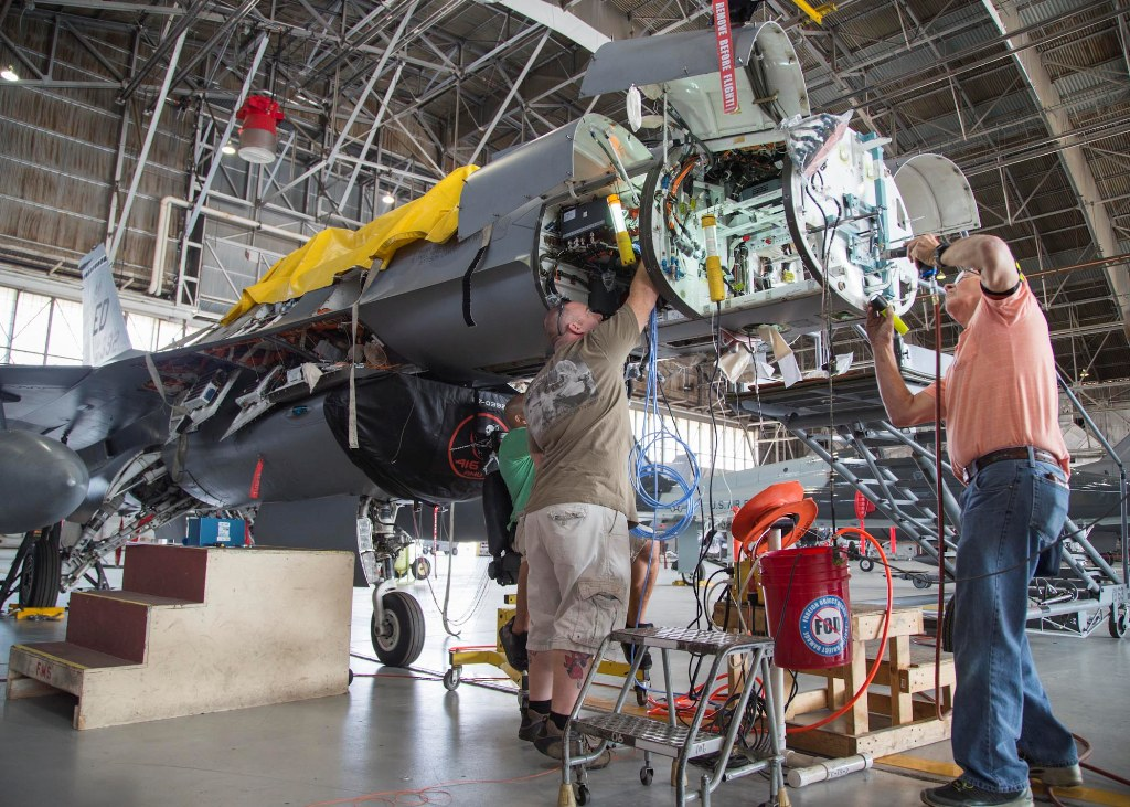 150821-F-HP195-### EDWARDS AIR FORCE BASE, Calif. (Aug. 21, 2015) Lockheed Martin technicians install hardware for mounting Scalable Agile Beam Radar (SABR) on an F-16 Fighting Falcon assigned to 416th Flight Test Squadron. Duifficulties were encountered during installation of mounting hardware, prompting technicians to make alterations to factory-supplied parts.