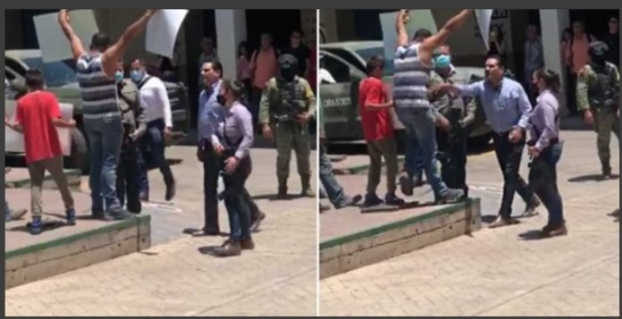Citizens boo Michoacan governor Silvano Aureoles for attacking a protester (VIDEO)