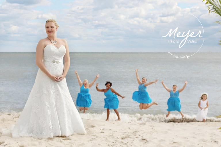 bride and bridesmaids on the beach